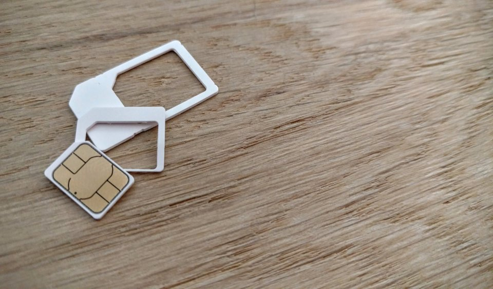Sim card and adapters on a wooden table